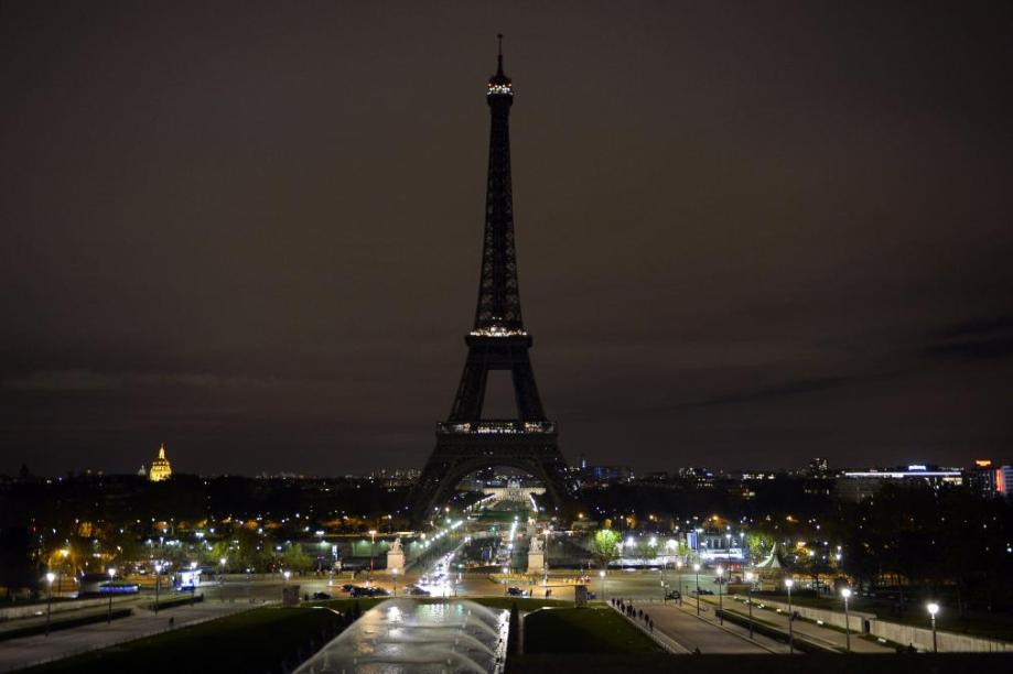 A picture taken on November 14, 2015 shows the Eiffel Tower with its lights turned off following the deadly attacks in Paris. Islamic State jihadists claimed a series of coordinated attacks by gunmen and suicide bombers in Paris that killed at least 129 people in scenes of carnage at a concert hall, restaurants and the national stadium. AFP PHOTO / ALAIN JOCARDALAIN JOCARD/AFP/Getty Images
